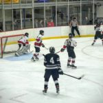 Defending in front of the Marquette Redmen's goal
