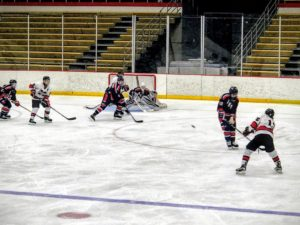The Marquette Redmen launch a shot on goal during their win against the Bay Reps on 97.5 GTO-FM