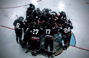 The Marquette Redmen huddling around the net as the game starts.