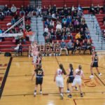 The Redettes in control of the ball going for another basket.