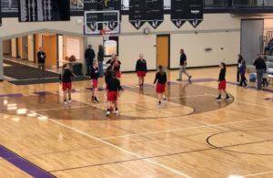 The Marquette Girls Varsity Basketball Team warming up on the Gladstone court.