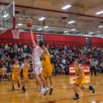 This Marquette Redmen barely has to jump to put the ball in the net!