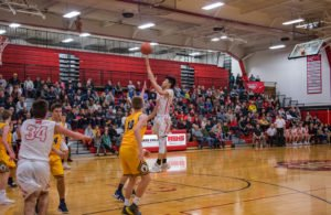 Another lay up for Marquette Redmen boys basketball player #3.