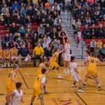 The Redmen take another shot at the basket.