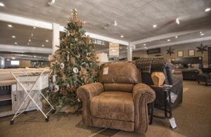 The Best Seat in the House display is located directly behind the service desk in Ashley HomeStore.