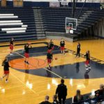 The Redettes warm up ahead of their game against the Brighton Bulldogs at the Petoskey Invitational.