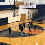The Brighton Bulldogs warm up as the home team at the Petoskey Invitational game opener against our Marquette Redettes.