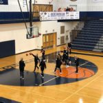 Brighton basketball warms up to take on our Redettes.