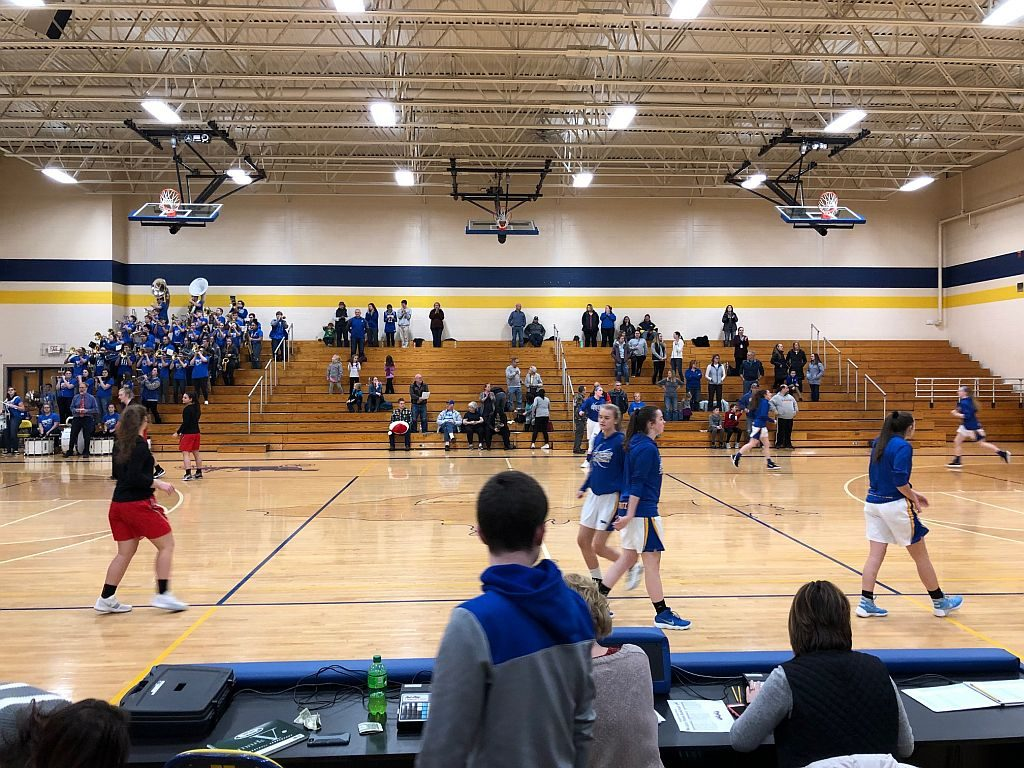 The Flivvers warm up on their home court.
