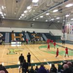 The Redmen warm up on the Green Bay Preble court.