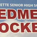 Marquette Redmen Hockey sign.