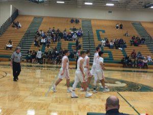The Redmen take the court.