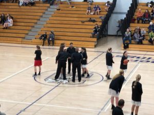The Marquette Redettes' captains head to center court to do the coin flip against Calumet Copper Kings