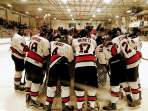 The Redmen in the huddle preparing to take on the Alpena Wildcats in Traverse City, MI