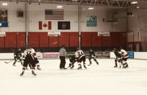 The puck drops for the game between your Marquette Redmen and the Alpena Wildcats at the Bay Reps Memorial Tournament