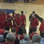 The Redmen huddle during a time out.