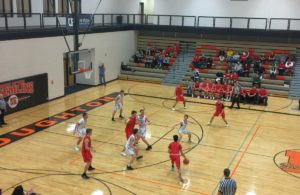 The Marquette Redmen drive toward the basket in Houghton on Tuesday night on 97.5 GTO-FM
