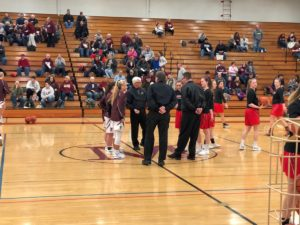 The Marquette Redettes and the Menominee Maroons watch the coin flip on 97.5 GTO-FM