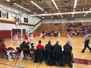 Action from behind the Marquette Redettes' bench during their game against the Menominee Maroons on 97.5 GTO-FM