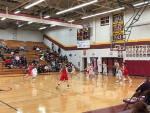 Action in the Marquette Redettes end of the court down in Menominee on Friday night