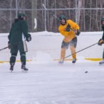 Shooting the puke down the ice toward the green side.