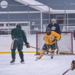 The yellow team in possession of the puck.