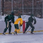 Some strong defense from the Green team, stealing the puck away.