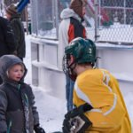 This little boy was telling NMU hockey player #3 all about this plans to be on the team one day.