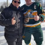 Todd Noordyk and one of the NMU Club Hockey Players.