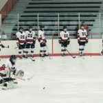 The Redmen warm up ahead of their bout against Gross Pointe South.