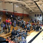 Eskymos fans cheer on the girls varsity team.