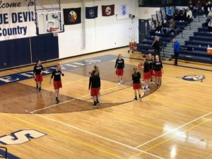 The Redettes warm up ahead of their game against the Sault Ste Marie Blue Devils.