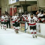 Redmen teammates congratulate each other for a goal.