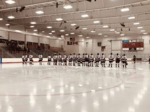 The Redmen get ready to face off against the Port Huron Northern Huskies.