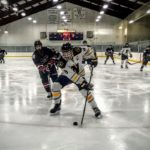 Miners defenseman guards the puck!