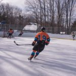 The Mutineers gain control of the puck to move it out of their zone.