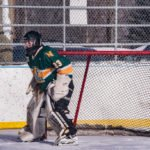 The NMU Club Hockey Goalie getting ready to block a shot.