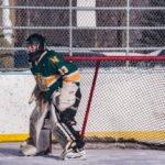 The NMU Club Hockey Goalie getting ready to block a shot.