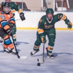 A NMU player moves the puck back down the ice into the Mutineers zone.