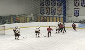 The Marquette Redmen take a face-off in the Cardinals' zone during their game Friday afternoon on FSM