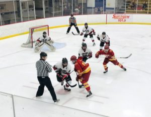 The Marquette Redmen take a face-off in their zone against the Hancock Bulldogs on 103-FXD