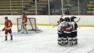 The Redmen celebrate after a goal during their battle with the Hancock Bulldogs Wednesday night