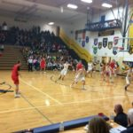 The Marquette Redmen work a play against the Negaunee Miners Thursday night