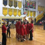 The Marquette Redmen and their coaches celebrate their win