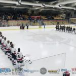 Teams line up for the National Anthem