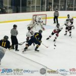 The Negaunee Miners win the draw in Marquette's zone