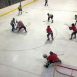 Another face-off in the Marquette Redmen's end of the ice