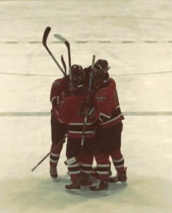 The Redmen celebrate after a goal in the second period