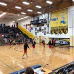 The Redettes warm up ahead of their game against the Negaunee Miners.