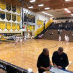The Negaunee Miners warm up.